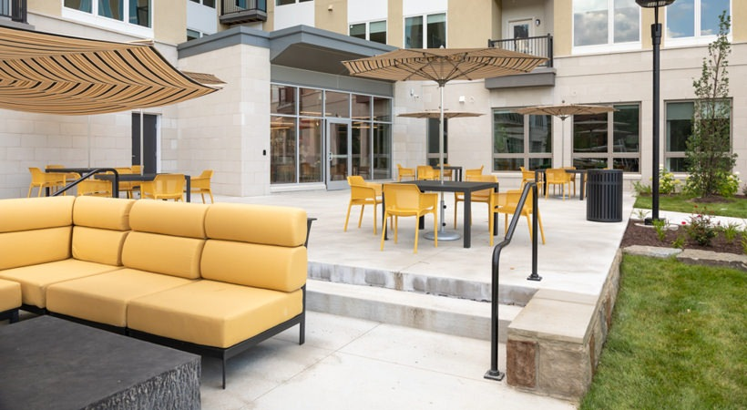 Outdoor patio features plenty of seating under umbrellas